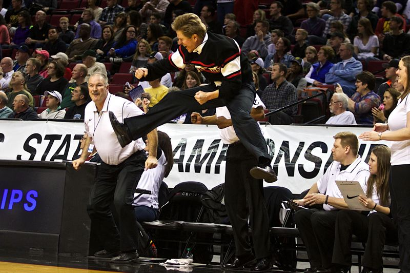 by: JAIME VALDEZ - Oregon City coach Kurt Guelsdorf takes flight as the final horn sounds in the championship final of the 2014 Class 6A High School Girls Basketball Tournament. Guelsdorfs Pioneers defeated top-ranked South Medford in the final to claim their first state championship since 2009.