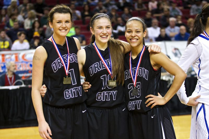 by: JAIME VALDEZ - Oregon City starters (left to right) Jessica Gertz, Cierra Walker and Toria Bradford were honored as three of the top players at the 2014 Class 6A State Champinship Tournament.