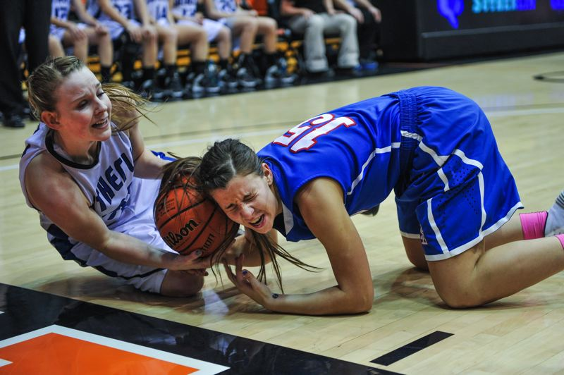 by: JOHN LARIVIERE - La Salle senior post Andrea Novak (right) battles Sutherlin junior Ricki Mock for a loose ball in Saturday nights championship final of the 2014 Class 4A State High School Tournament.