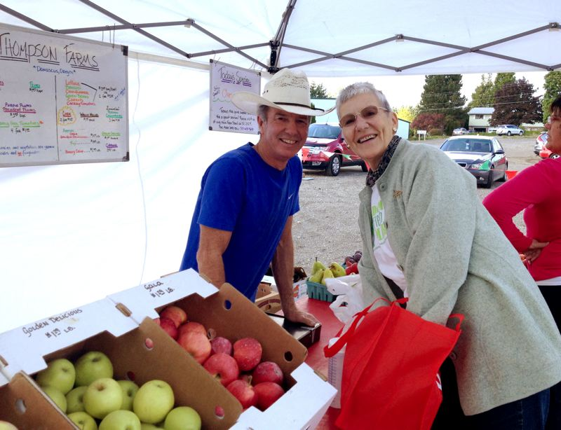 by: CONTRIBUTED - The Damascus Fresh & Local Market starts in May, but volunteers, vendors and musicians are needed now. Pictured at last years market are Larry Thompson, owner of Thompson Farms, left, and Rakul Ketels.