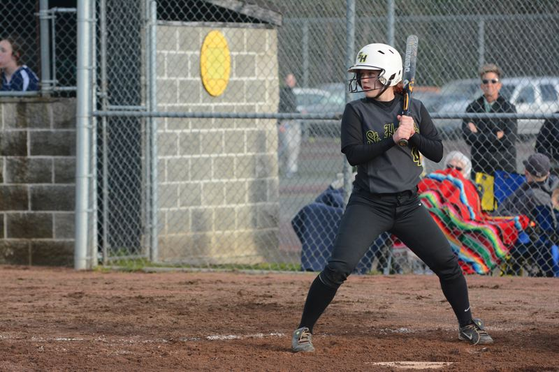 by: JOHN WILLIAM HOWARD - St. Helens sophomore Ashley Geisbers awaits a pitch during the Lions' season opener on March 17. Geisbers came up with both hits for the Lions, and advanced as far as third base, but couldn't get anything to home plate.