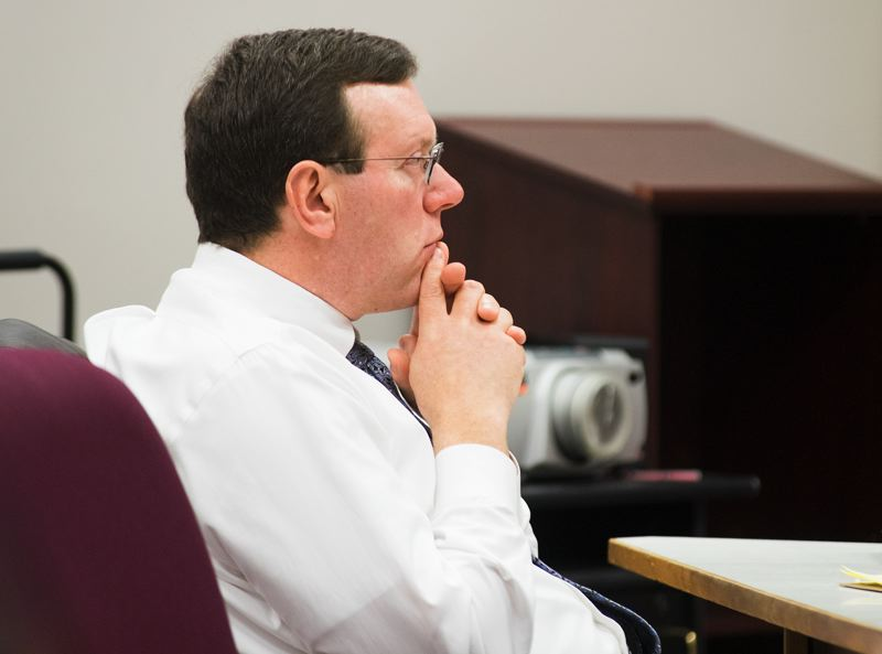 by: NEWS-TIMES PHOTO: CHASE ALLGOOD - Throughout his trial on sex abuse charges, Pacific University vice-president Michael Mallery has alternated between staring intently at the jury and taking notes.