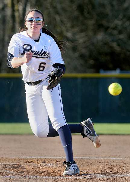 by: SETH GORDON - Stand and deliver - Senior pitcher Erin Hento, who struck out five batters in seven innings, unleashes a pitch during George Fox's 6-2 win over Lewis & Clark March 11 at Morse Field.