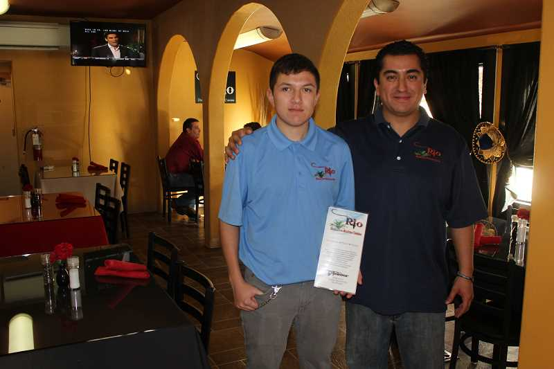 Erik Diaz, left, is learning about being a chef from mentor Raul Arriaga at Rio Restaurant.