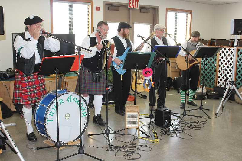 by: SUSAN MATHENY/MADRAS PIONEER - Tiur Amadan entertains at the senior center in Madras.