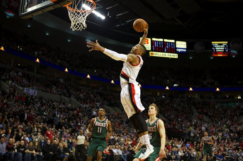 by: TRIBUNE PHOTO: JAIME VALDEZ - Damian Lillard dunks in overtime to help the Trail Blazers defeat the Milwaukee Bucks.