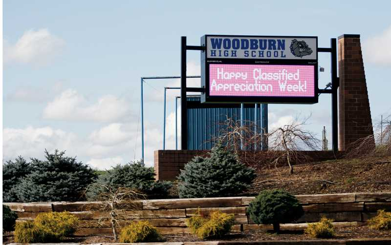 by: PHIL HAWKINS - The new reader board outside Woodburn High School displays news for the entire Woodburn School District.