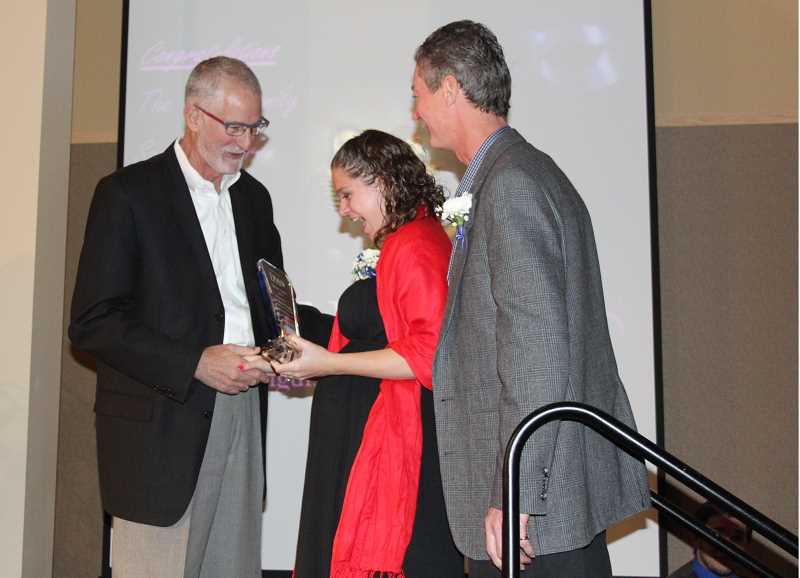 by: NIKKI DEBUSE - Tana Jo Neliton and Ronny Webb are pictured receiving their award from Silverton Health CEO Rick Cagen.