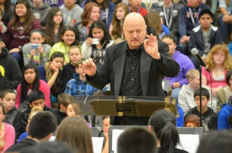 by: JANIS BRENTANO - Larry Johnson conducts the Portland Youth Wind Ensemble at Valor Middle School Wednesday.