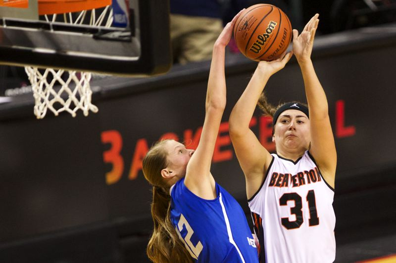 by: TIMES PHOTO: JAIME VALDEZ - Beaverton Gigi Stoll puts up a jumper against South Medford Panthers in the second half of the 6A girls semifinals at Moda Center.