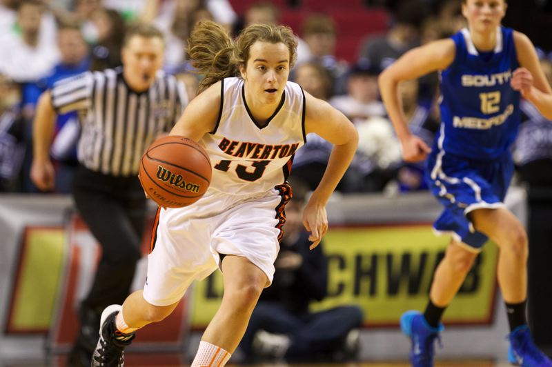 by: TIMES PHOTO: JAIME VALDEZ - Beaverton Beavers guard Alyssa Christiansen (13) brings the ball up court against South Medford Panthers in the second half of the 6A girls semifinals at Moda Center.