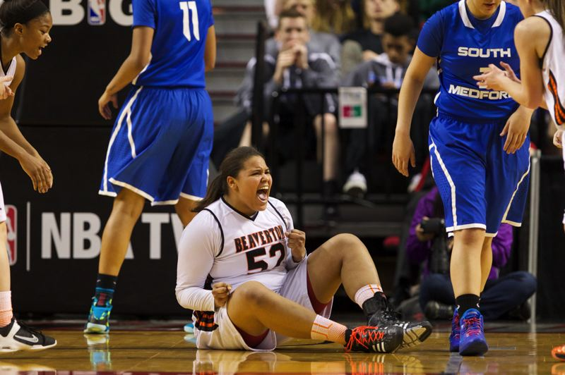by: TIMES PHOTO: JAIME VALDEZ - Beaverton Beavers power forward Shaunta Jackson (52) reacts after drawing an offensive foul against South Medford Panthers in the second half of the 6A girls semifinals at Moda Center.