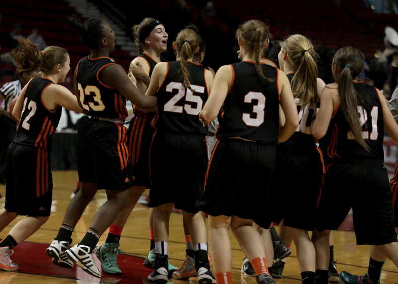 by: TIMES PHOTO: JONATHAN HOUSE - Beaverton players celebrate their win over Clackamas.