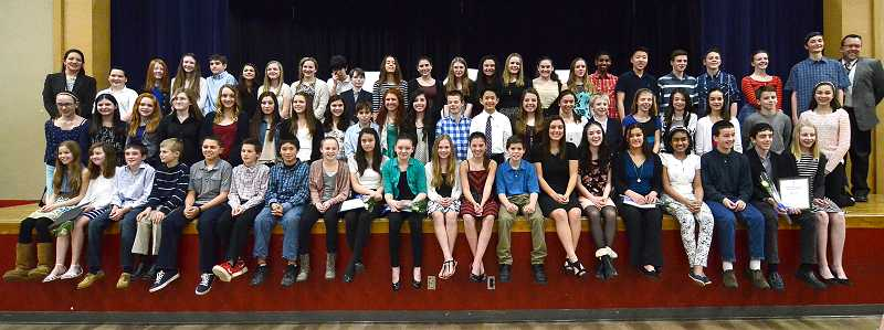 by: REVIEW PHOTO: VERN UYETAKE - Lake Oswego Junior High students were inducted into their schools first chapter of the National Junior Honor Society.