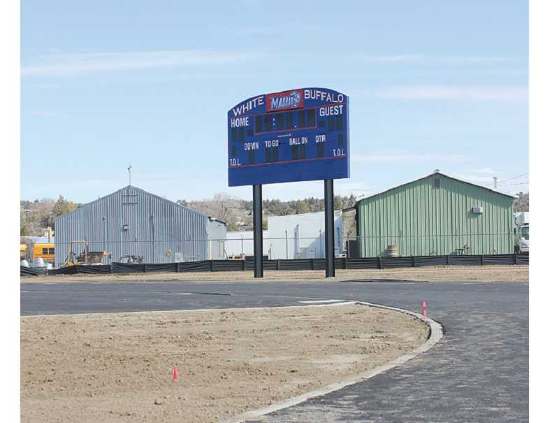 by: SUSAN MATHENY - The new scoreboard on the partially completed Madras High School track and football field has a built-in speaker system. That track has been paved, but may be getting an upgraded surface.