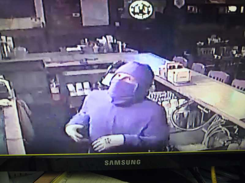 Sherwood Police say this man climbed into Clancy's Pub through a roof hatch, stole bottles of alcohol, then climbed back out again.