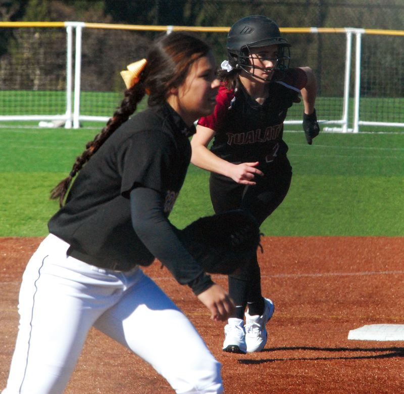 by: DAVID BALL - ON THE MOVE -- Tualatin senior Beth Fanger (right) looks to move from second to third base during Tuesday's win over Barlow.