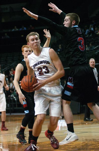by: DAN BROOD - UNDER THE ARMS -- Sherwood senior Lucas Johnson (left) drives past Madison's Adam Wright.