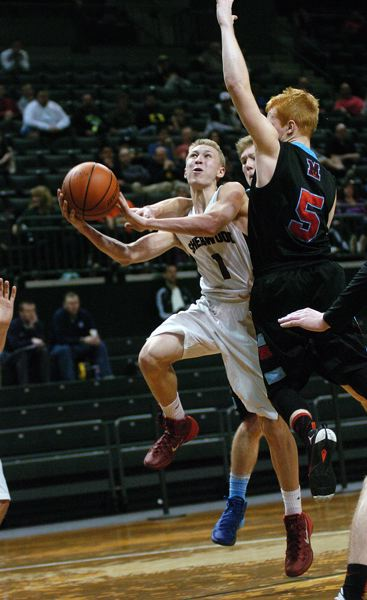 by: DAN BROOD - TAKING OFF -- Sherwood junior guard Evan Kitto (1) gets past Madison's Mak Hutson as he goes to the basket.