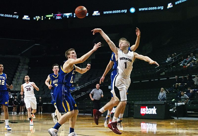 by: DAN BROOD - GET IT INSIDE -- Sherwood High School junior point guard Evan Kitto (1) passes the ball inside against the Bend defense in Friday's Class 5A state tournament consolation quarterfinal.