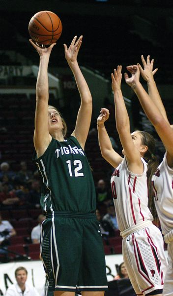 by: DAN BROOD - JUMPER -- Tigard sophomore Elise Conroy shoots over Oregon City defenders at the state tourney.