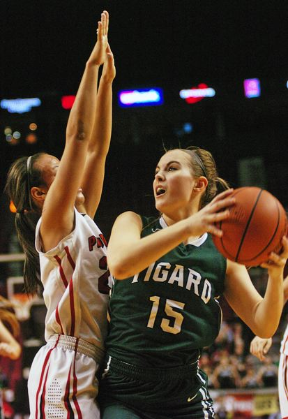by: DAN BROOD - BATTLE INSIDE -- Tigard senior Jessie King (right) looks to go up to the basket against Oregon City's Toria Bradford.