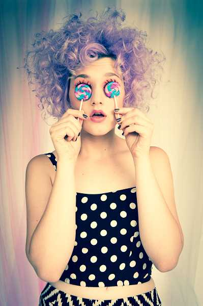 by: COURTESY OF RAINA STINSON PHOTOGRAPHY - Raina Stinson's photograph entitled 'Eye Candy,' depicting Malia Rodgers, clad in a polka dot dress with a halo of frosty curls and huge lollipops for eyes, is one of three selected to be shown in Spain.