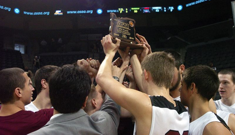 by: DAN BROOD - TROPHY TIME -- Sherwood High School players and coaches gather with the fourth-place trophy following the team's win over Wilsonville in the Class 5A state tournament fourth-place game in Eugene.