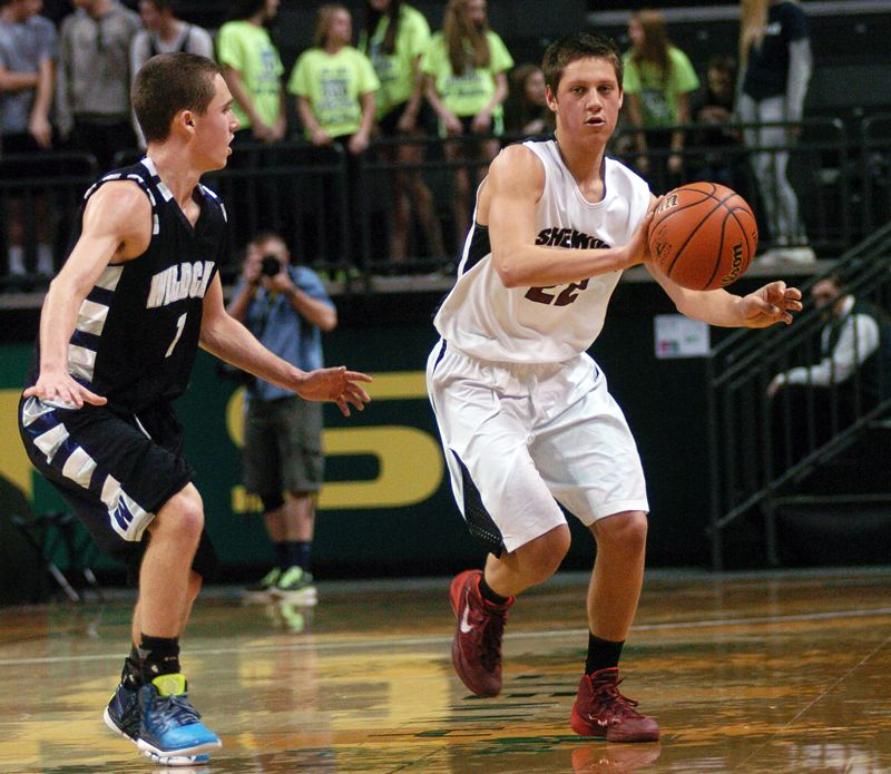 by: DAN BROOD - BOWMEN ON THE GO -- Sherwood senior guard Alex Castaneda (right) passes the ball up court.
