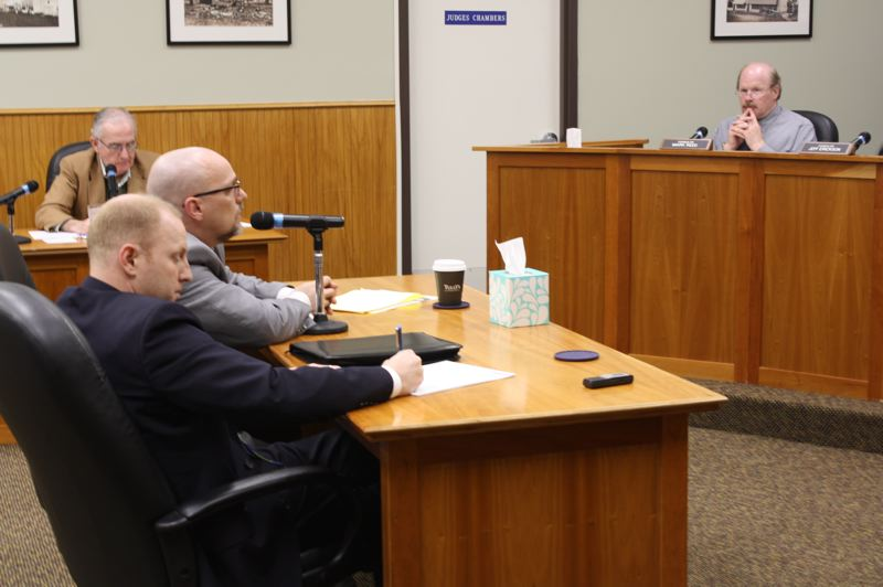 by: SPOTLIGHT PHOTO: ROBIN JOHNSON - Barram Liebman LLP partner Todd Lyon (speaking) and associate Kyle Abraham explain the firm's approach to new clients at a City Council meeting March 17.