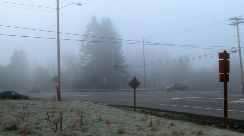 by: MARK MILLER - The intersection of Northwest Cornelius Pass Road and Northwest Skyline Boulevard on a foggy morning. The intersection, which currently requires traffic on Skyline Boulevard to stop for traffic on Cornelius Pass Road, is one of several 'hotspots' being studied for prospective safety improvements as part of a Multnomah County road project.
