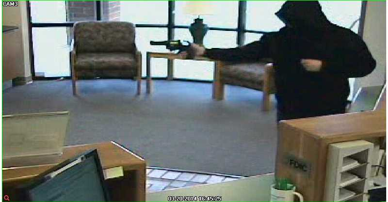 by: SUBMITTED - This photo is of the suspect at the Washington Federal Bank Thursday afternoon.