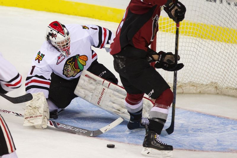 by: TRIBUNE PHOTO: JAIME VALDEZ - Portland goalie Brendan Burke battles to make a save against Vancouver.