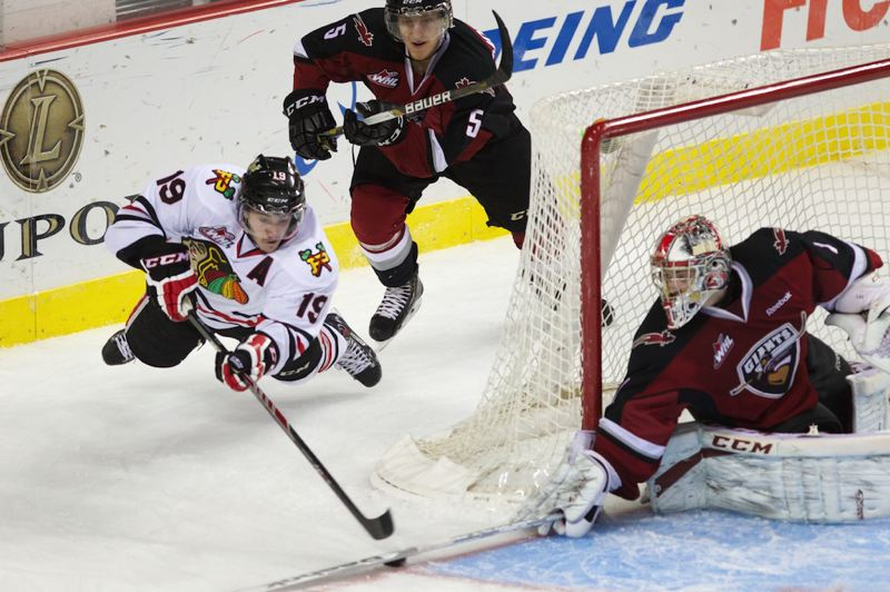 by: TRIBUNE PHOTO: JAIME VALDEZ - Nic Petan of the Winterhawks tries to get one past the Giants.