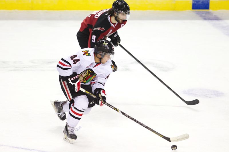 by: TRIBUNE PHOTO: JAIME VALDEZ - The Winterhawks' Keoni Texeira takes the puck away from Vancouver Giants' Dalton Sward.
