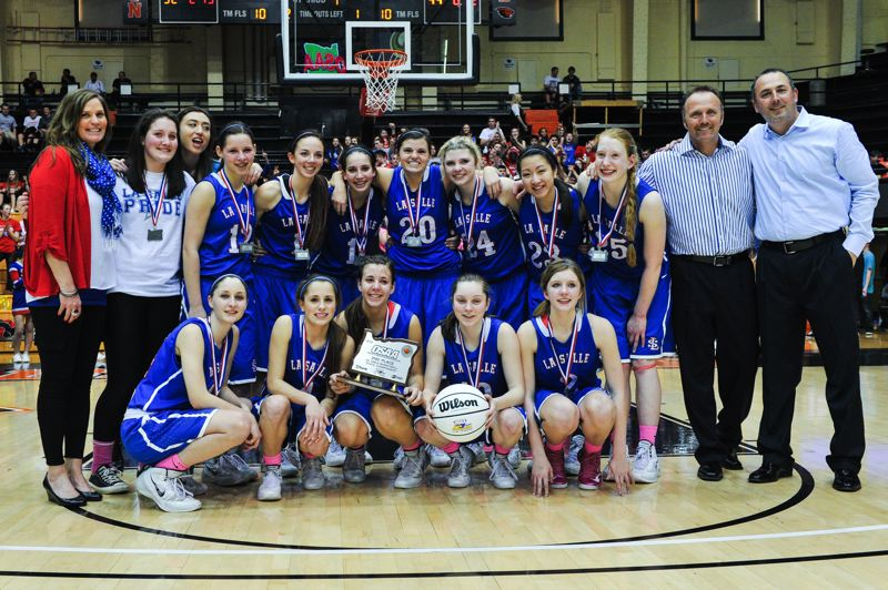 by: JOHN LARIVIERE - La Salle Preps girls basketball team had a tremendous season in 2013-14, going undefeated in the Tri-Valley Conference for the second year in a row, finishing with an overall record of 25-2, and placing second at the 2014 Class 4A State Tournament. Pictured with their hardware from the state tournament are La Salle players and coaches: (first row, from left) Mattie Portash, Courtney Crain, Andrea Novak, Allison Ilg and Sterling Swift; and (standing) head coach Kelli Wedin, Maddie Hill, Mary Olarte, Makenzie Cook, Tori Goodman, Aleah Goodman, Morgan McSmith, Ally Jansen, Shannon Tran, Katie Buerk, coach Darrell McSmith and coach Kevin Goodman.