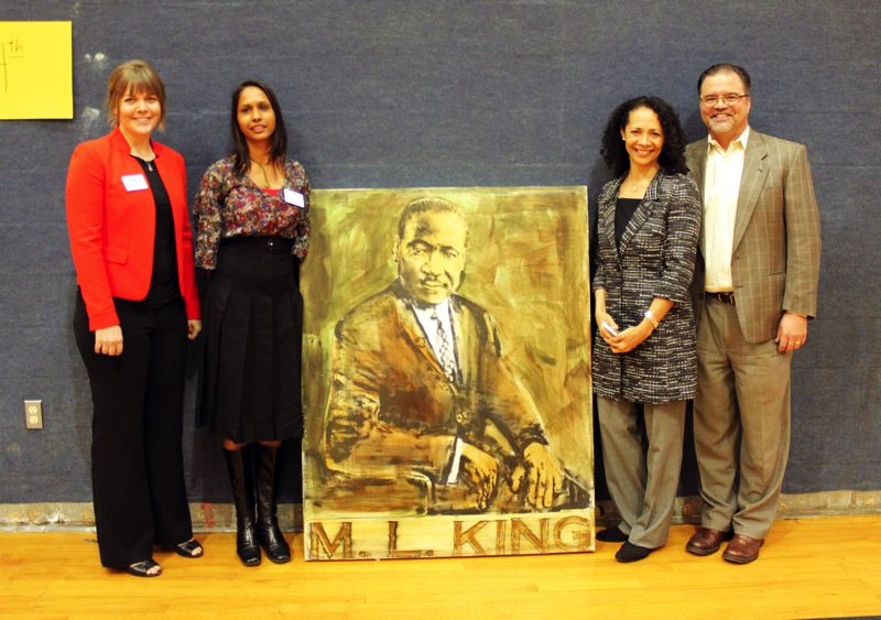 by: CONTRIBUTED PHOTO: SOPHIE BANNER - Left to right: Emily Gaither, Shyvonne Williams, Jessica Stanton and Mark Langseth show off Alder's new MLK Jr. painting.