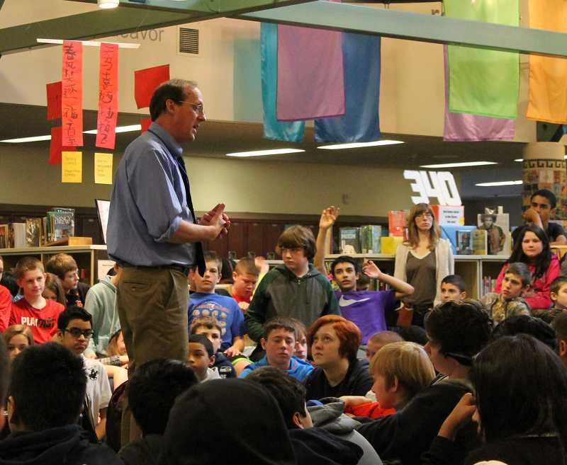 by: SPOKESMAN PHOTO: KATE HOOTS - Gary Schmidt discusses his young adult novel 'OK for Now' with seventh-graders in the Wood Middle School library March 5. Schmidt's appearance capped the yearlong Wood Reads program.