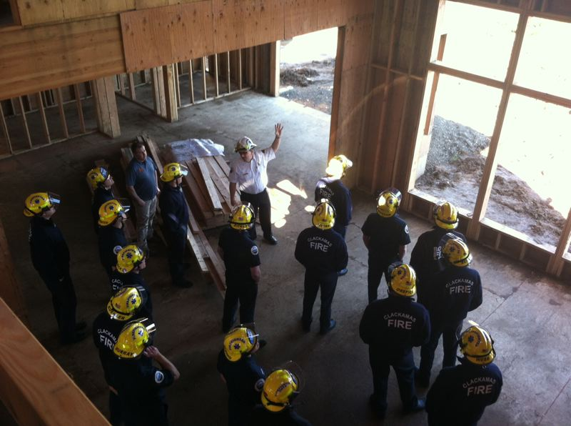 by: PHOTO COURTESY: BRANDON PAXTON - Clackamas Fire Battalion Chief John Oliver teaches firefighters about home construction at the Northern Heights Street of Dreams in Happy Valley.