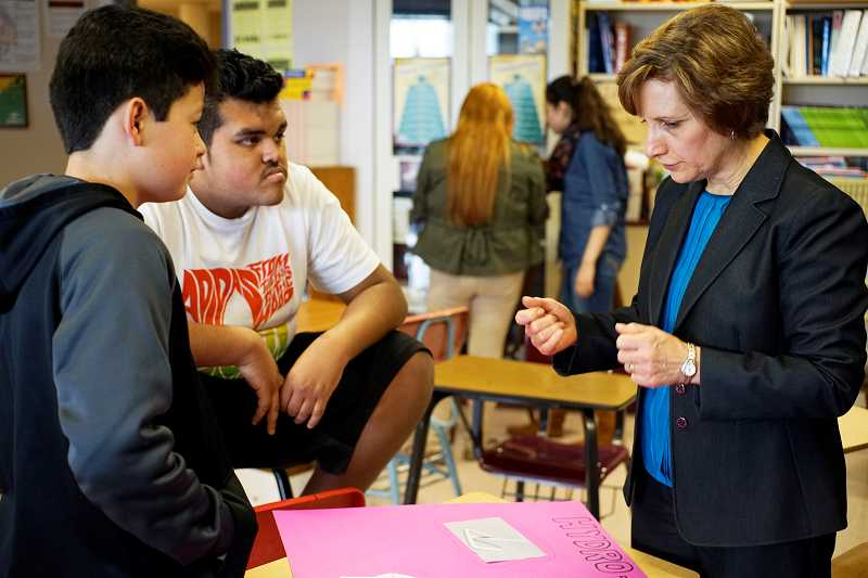 by: NEWS-TIMES PHOTO: CHASE ALLGOOD - U.S. Rep. Suzanne Bonamici talks with students in Forest Grove High Schools after-school 4-H program during a swing through Washington County March 19.