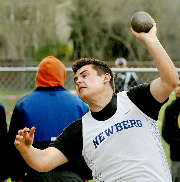 by: SETH GORDON - Heave-ho! - Sophomore Chase Pothier launches the shot put March 19 at the Sherwood preseason meet. Pothier placed second in the junior varsity competition with a mark of 36-1.