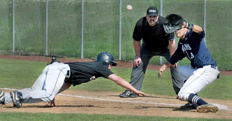 by: SETH GORDON - Not so fast - George Fox first baseman Derek Dixon gathers the ball in an attempt to pick off a Whitman runner Sunday during the Missionaries'    2-1 victory at Morse Field. Pitcher Tom Zarosinski and Dixon were unsuccessful on this attempt, but nailed the runner on the next attempt.