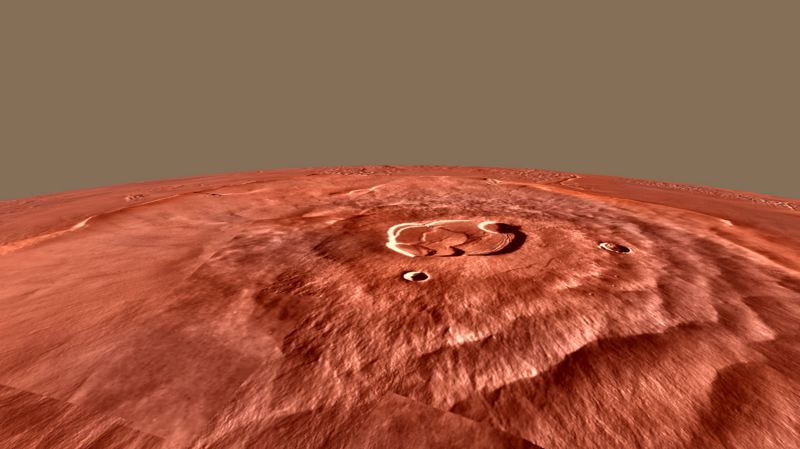 by: CONTRIBUTED PHOTO - The shield volcano Mons Olympus on Mars is the second tallest mountain in our solar system, standing almost 14 miles high.