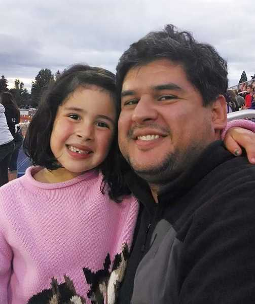 by: SUBMITTED - Jorge Martinez, pictured with his daughter, Jimena, is the newest employee of CAPACES Leadership Institute. His position as evaluation project assistant is funded through a grant from the Meyer Memorial Trust.
