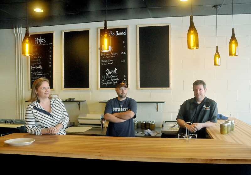 by: GARY ALLEN - New business - Storrs Smokehouse, almost ready for  business, is a partnership between (from left) Jessica Bagley, Loal Stahlnecker and Allen Routt, all of  The Painted Lady restaurant. The smokehouse is    slated to open April 5.