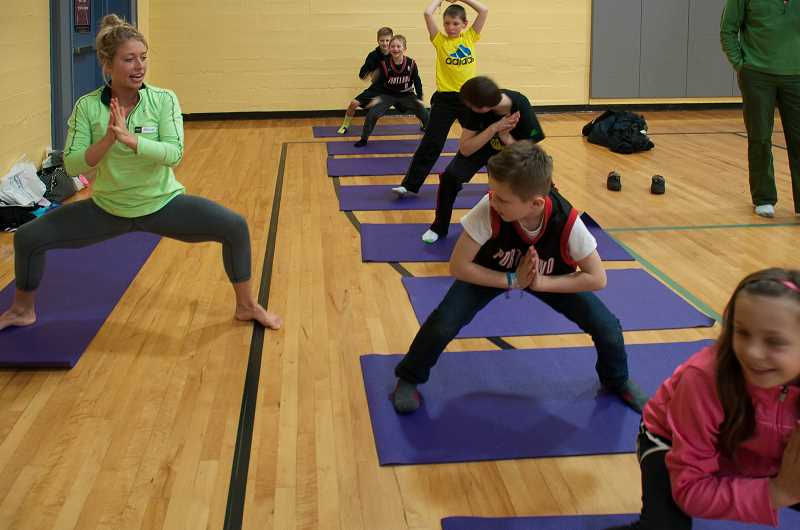 by: SUBMITTED PHOTO - Yoga was one of the exercise options for families to explore at Sunset Primarys Family Fitness and Nutrition night.