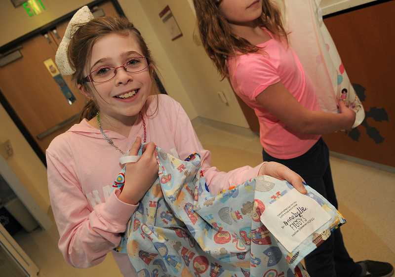 by: REVIEW PHOTO: VERN UYETAKE - Hallinan fourth-grader Annabelle Hay inspired the gift of homemade gowns to the Shriners in Portland.