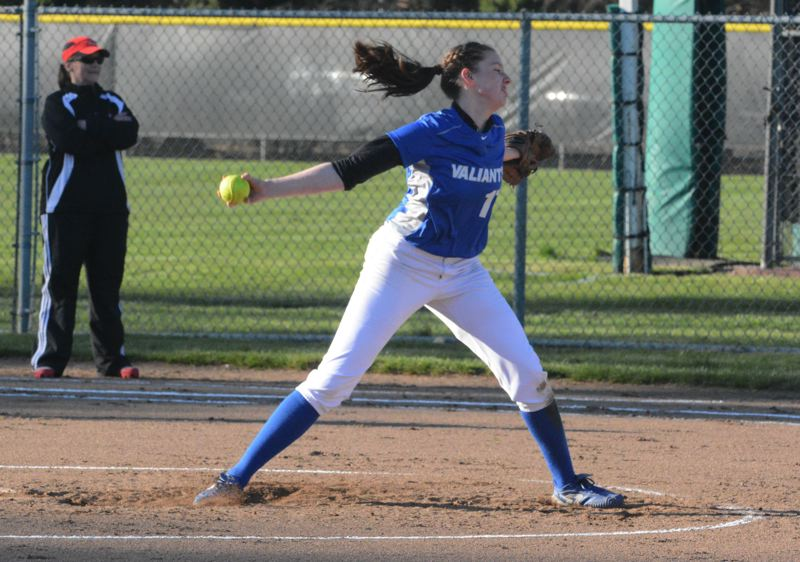 by: TIMES PHOTO: MATT SINGLEDECKER - Valley Catholic sophomore pitcher Molly Danielson says she's much improved in the circle from a year ago and hopes to carry the Valiants this season.