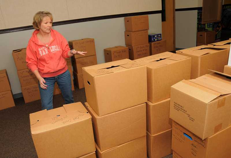 by: REVIEW FILE PHOTO: VERN UYETAKE - Lake Grove Elementary School Principal Carol Whitten helped pack up the former Uplands Elementary School when she was principal there. The school's final days were in June 2012, but it could reopen, depending on a real estate study.