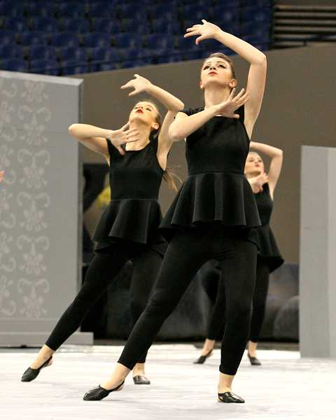 by: TIDINGS PHOTO: J. BRIAN MONIHAN - Abby Schrader, left, and Natalie Bruun pose during the Debs routine.